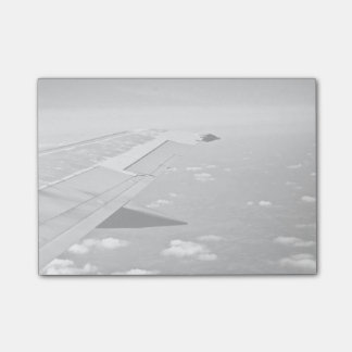 Plane Themed, Grayscale Airplane Wings Flying Over Post-it Notes