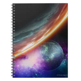Planet and its moon. Computer artwork of an Notebook