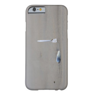 plastic fork sticking in sandy beach beside barely there iPhone 6 case