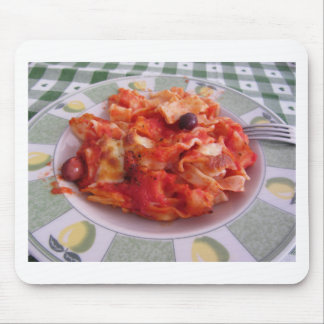 Plate of home made baked pasta on white background mouse pad