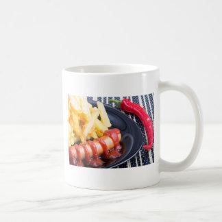 Plate with a portion of fried potatoes coffee mug