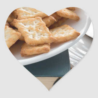 Plate with crackers and cup of tea heart sticker
