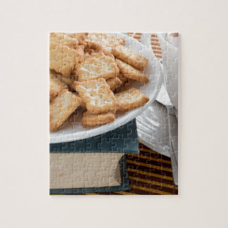 Plate with crackers and cup of tea jigsaw puzzle
