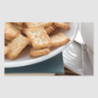 Plate with crackers and cup of tea rectangular sticker