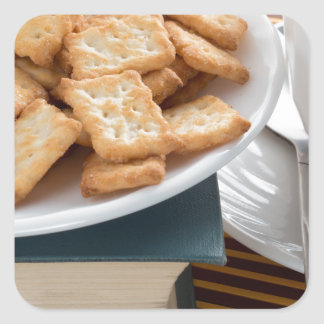 Plate with crackers and cup of tea square sticker