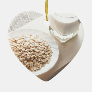 Plate with dry cereal and a glass of milk ceramic heart decoration