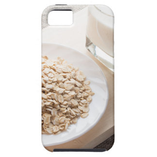 Plate with dry cereal and a glass of milk iPhone 5 covers