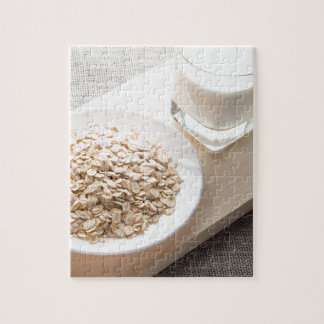 Plate with dry cereal and a glass of milk jigsaw puzzle