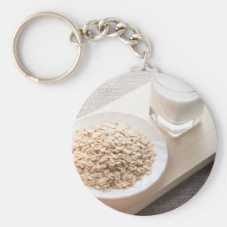 Plate with dry cereal and a glass of milk key ring
