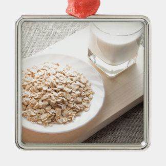 Plate with dry cereal and a glass of milk Silver-Colored square decoration
