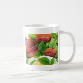 Plate with egg yolk, fried bacon and herbs coffee mug