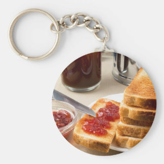 Plate with fried slices of bread for breakfast key ring