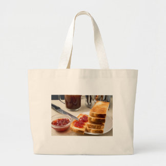 Plate with fried slices of bread for breakfast large tote bag