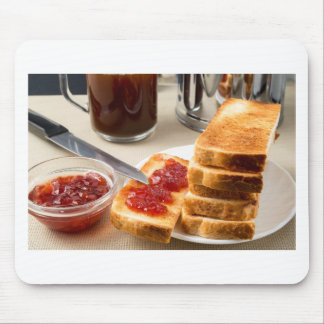 Plate with fried slices of bread for breakfast mouse pad