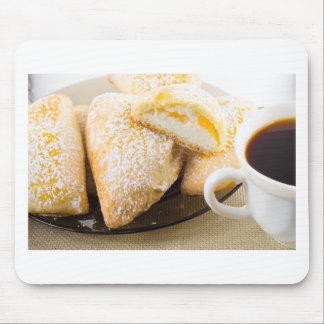 Plate with sweet pastries with sweet cheese mouse pad