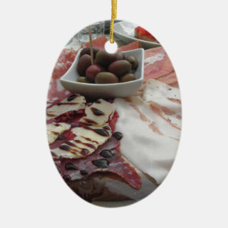 Platter of cold cuts with rustic ham prosciutto ceramic oval decoration