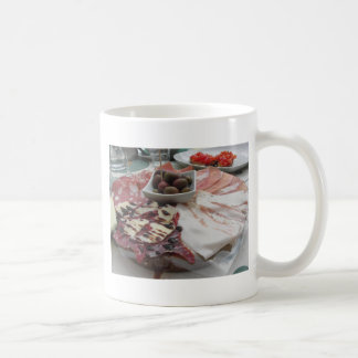 Platter of cold cuts with rustic ham prosciutto coffee mug