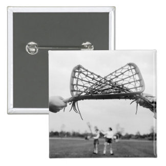 Play starts in a lacrosse team with the draw.Two 15 Cm Square Badge