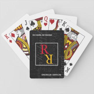 player monogram on black playing cards