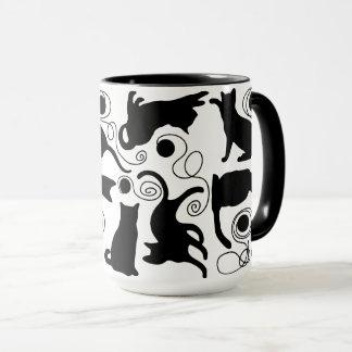 Playful Cats and Yarn Silhouettes Mug