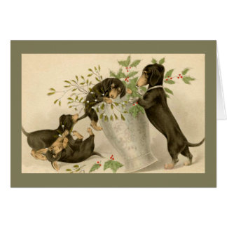 Playful daschunds with holly berry and vase greeting card