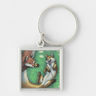 Playful foxes key ring