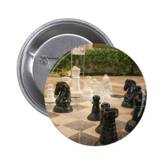 Playing a game of Chess Pinback Buttons
