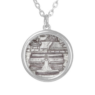Playing piano on a rainy day silver plated necklace