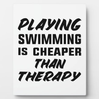 Playing Swimming is cheaper than therapy Plaque