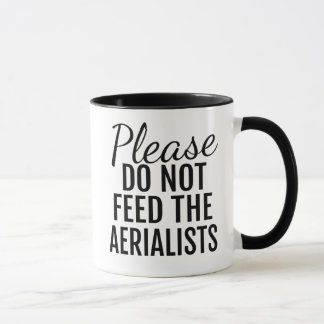 Please Do Not Feed The Aerialists Coffee Mug