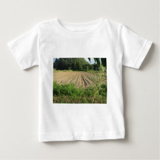 Plowed field in the late afternoon in Tuscany Baby T-Shirt