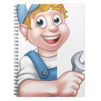 Plumber or Mechanic Holding a Spanner Notebooks