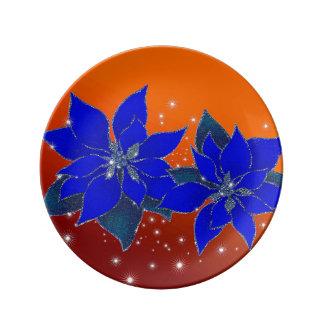 Poinsettias blue on yellow bottom porcelain plates