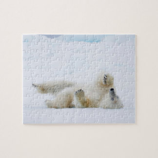 Polar bear rolling in snow, Norway Puzzle