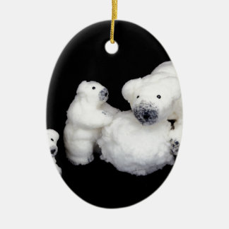 Polar bears family figurines playing with snowball ceramic oval decoration