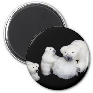 Polar bears family figurines playing with snowball magnet