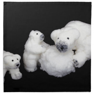 Polar bears family figurines playing with snowball napkin