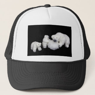 Polar bears family figurines playing with snowball trucker hat