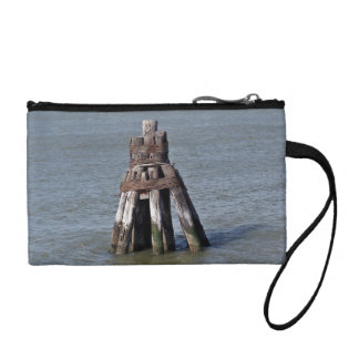 Poles standing in water coin purses