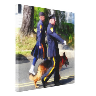 Policeman and Police Dog in Parade Canvas Prints