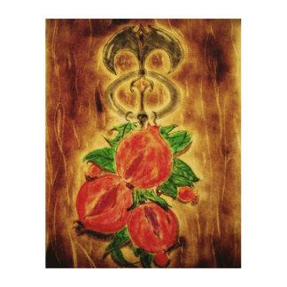 Pomegranates hung from a door knocker wood print