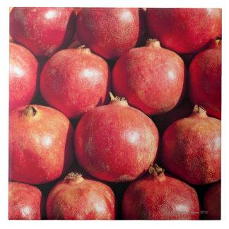 Pomegranates on display at the Carmel Market Large Square Tile