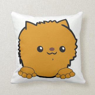 pomeranian peeking orange cushion