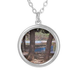 Pond and trees in a park jewelry