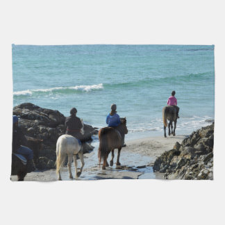 Pony trekking along the beach tea towel