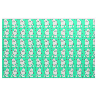 Poodles on green fabric