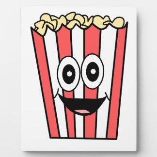 popcorn smiling plaque