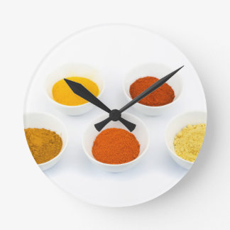 Porcelain bowls with several seasoning spices clock