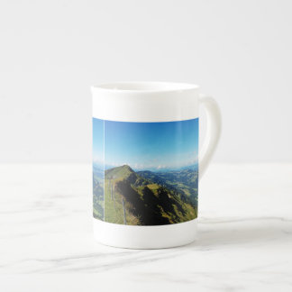 Porcelain cup of alps with upper baptism in the bone china mug