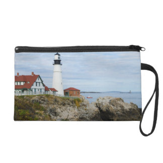 Portland Headlight lighthouse on rocky shore Wristlet Clutches
